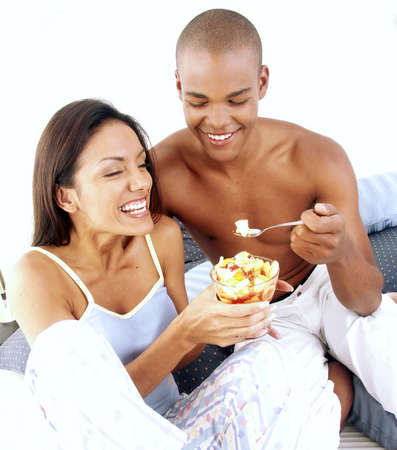 frolicking: Young Hispanic couple enjoying bowl of salad Stock Photo