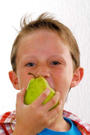 chomp: Little kid biting a pear
