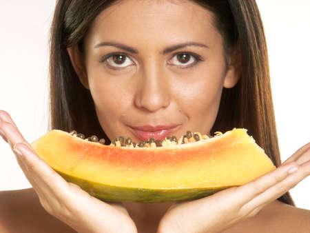 Beautiful woman with sliced papaya Stock Photo