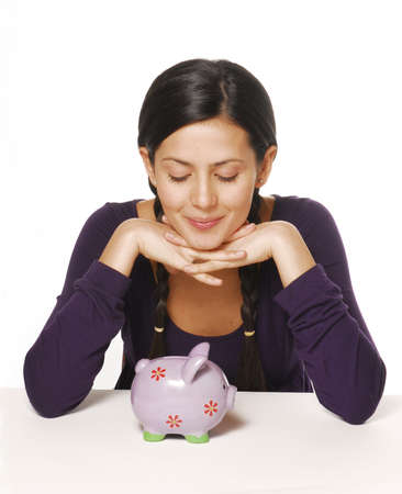 shilling: Beautiful woman with piggy bank