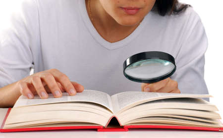 Woman with magnifying glass and book