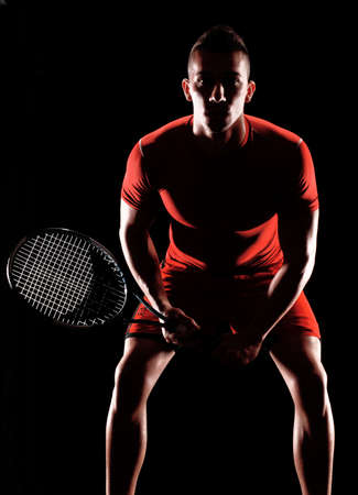 male tennis players: Young man holding a tennis racket on white background