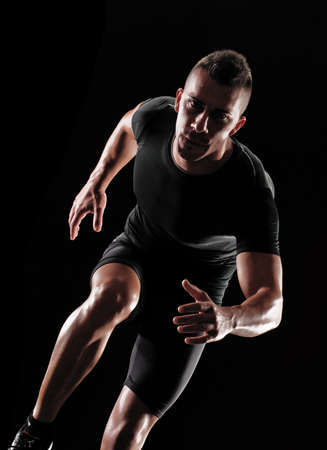 Portrait of a runner on white background  Standard-Bild
