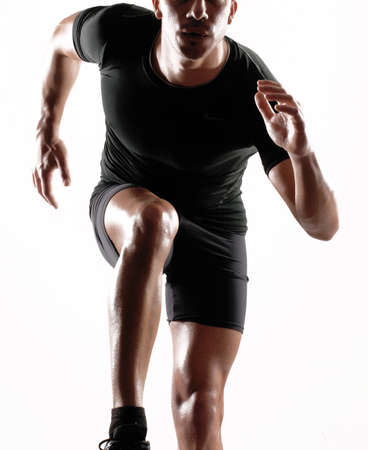 dynamics: Portrait of a runner on white background  Stock Photo