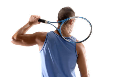 Young man holding a tennis racket on white background