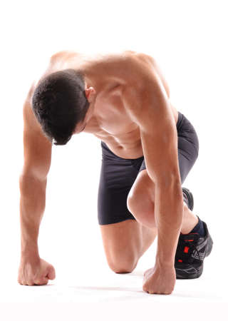 Young fitness man on running position