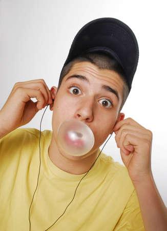 bubblegum: Young man blows a bubblegum Stock Photo