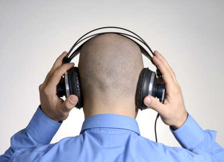 Businessman is using his headphones photo