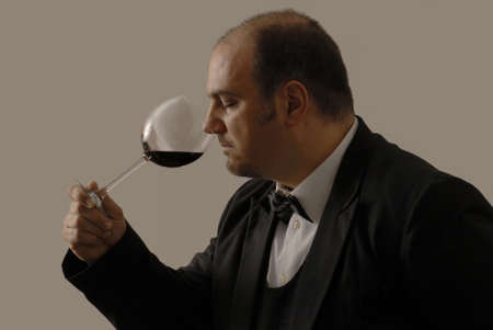 Young sommelier is tasting the red wine Stock Photo