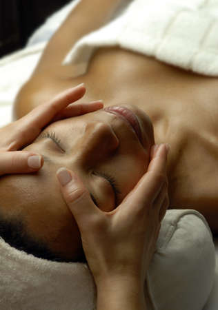 black woman face: Beautiful young black woman getting a face treatment at beauty salon