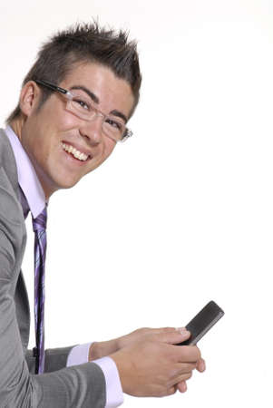 Young businessman is holding his handphone  Stock Photo - 22301269