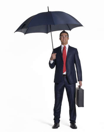cautious: Young businessman holding an umbrella