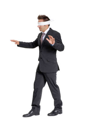 blindfold businessman walking on white background