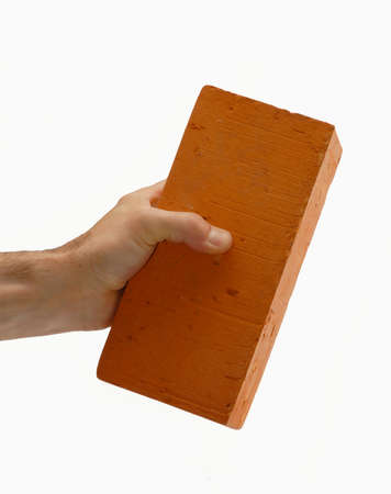 Holding a brick Stock Photo