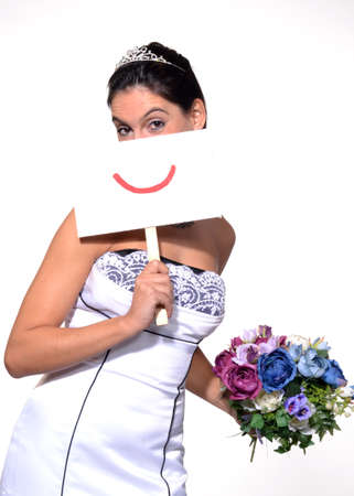 emote: Bride holding a sign with a smiley face and flowers