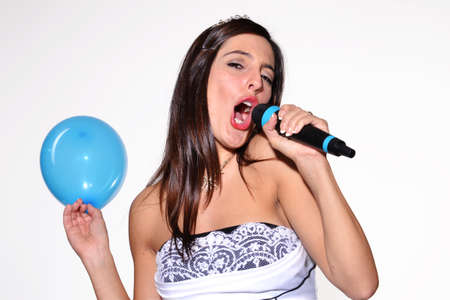 Bride holding a balloon and singing