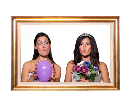 puckered: Photo of a bride and bridesmaid
