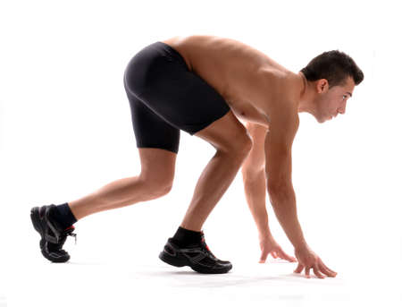 Man in ready position to run photo