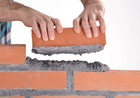 Laying bricks Stock Photo