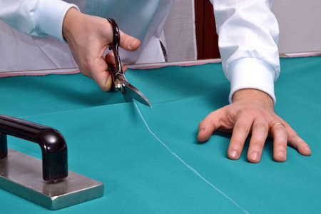 snipping: A tailor cutting fabric Stock Photo