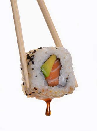 Chopsticks holding a piece of sushi Stock Photo