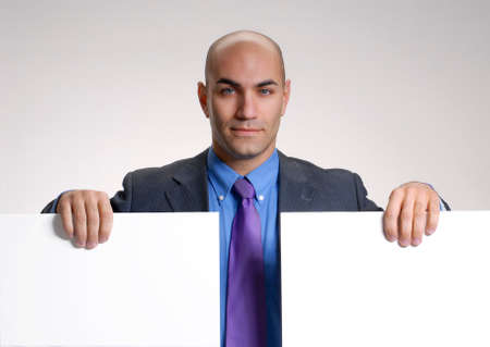 Businessman with two blank boards photo