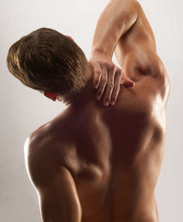 Back view of a muscular man photo