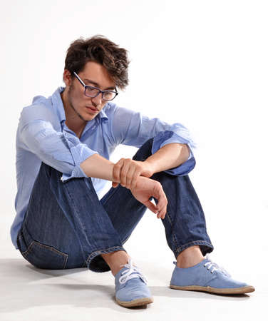 Man with glasses posing