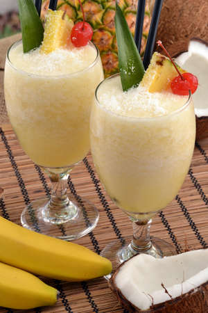 colada: Pina colada cocktail drinks and tropical fruits