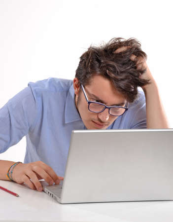 Man staring at laptop screen photo