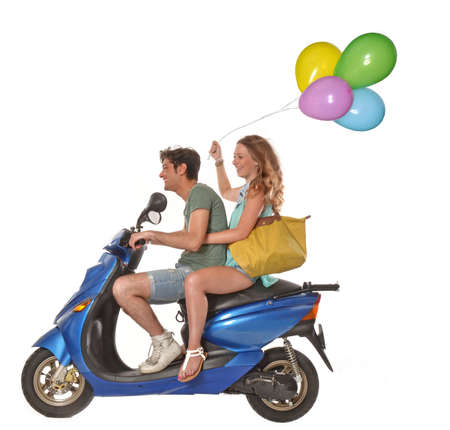 Couple riding a scooter Stock Photo
