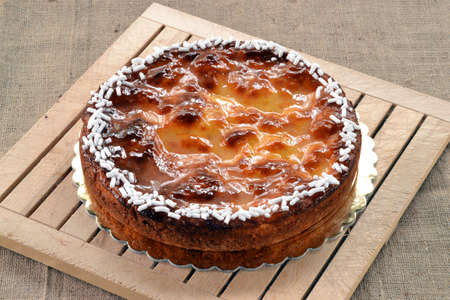 provocative food: Peach fruit cake on rustic wood table. Stock Photo