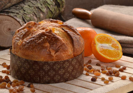 fresh bakery: Panettone bread and ingredients on rustic wood ambient.Panetone and ingredients.Traditional christmas food.
