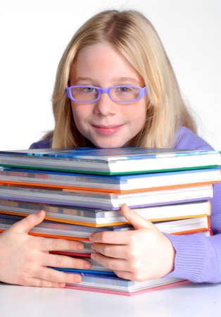 studding: School girl portrait behind books. Stock Photo