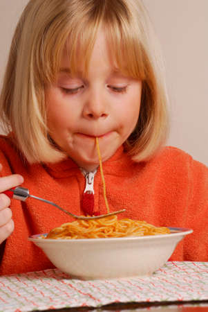 provocative food: Little girl eating pasta,kid eating pasta, Stock Photo