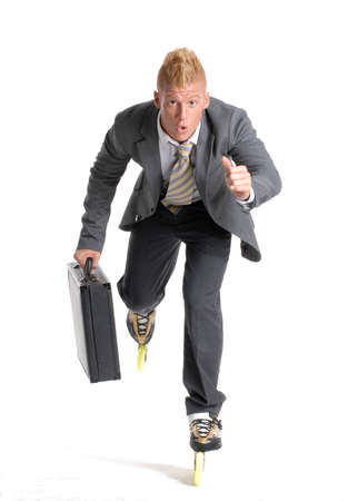 witty: Young businessman skating on white background. Stock Photo
