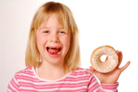 vanilla cake: Little girl eating cake. Little kid eating vanilla cake.
