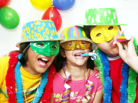 costume party: Three funny carnival kids portrait enjoying together Stock Photo