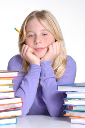 disciplined: School girl portrait behind books. Stock Photo