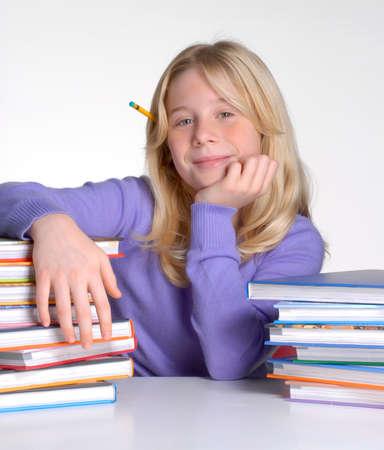 School girl portrait behind books. Banco de Imagens