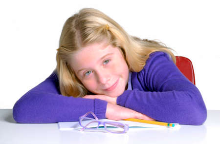 disciplined: School girl portrait on white background.