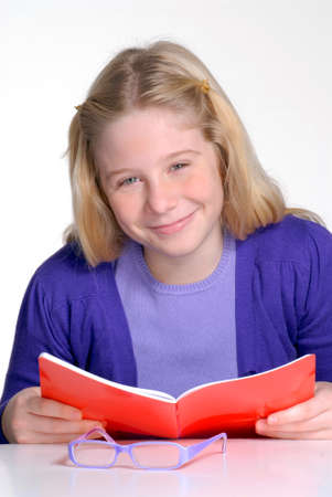 studding: School little girl reading and studding.