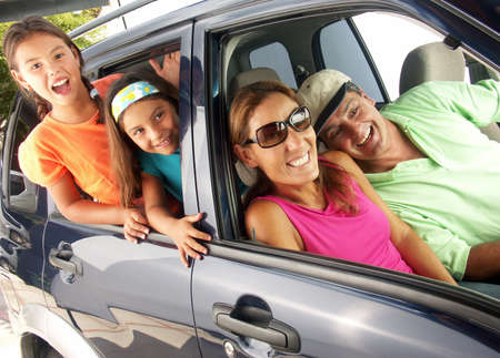 family vacation: Happy family traveling on a car. Stock Photo