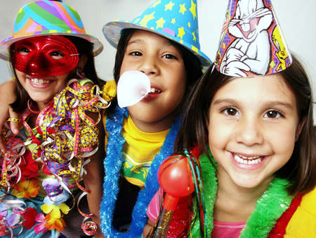 Three funny carnival kids portrait enjoying together.