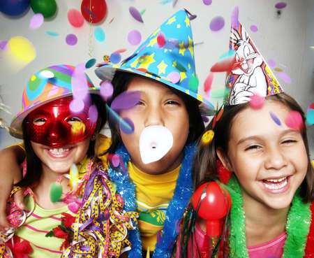 costumes: Three funny carnival kids portrait enjoying together.