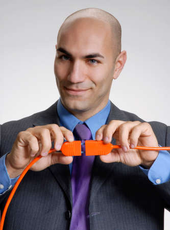 Businessman connecting cables Stock Photo
