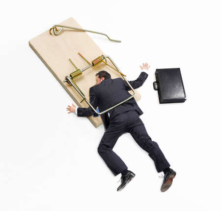 Businessman trap,businessman failure,businessman on mousetrap on white background.