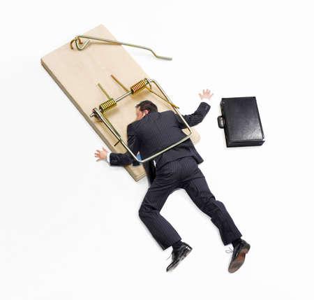 mousetrap: Businessman trap,businessman failure,businessman on mousetrap on white background.