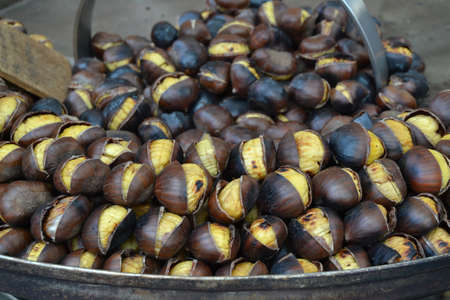 man nuts: Roasting chestnuts outdoors