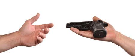 holding gun: Giving a gun,surrender concept.Peace concept.